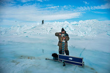 Researcher taking ice core