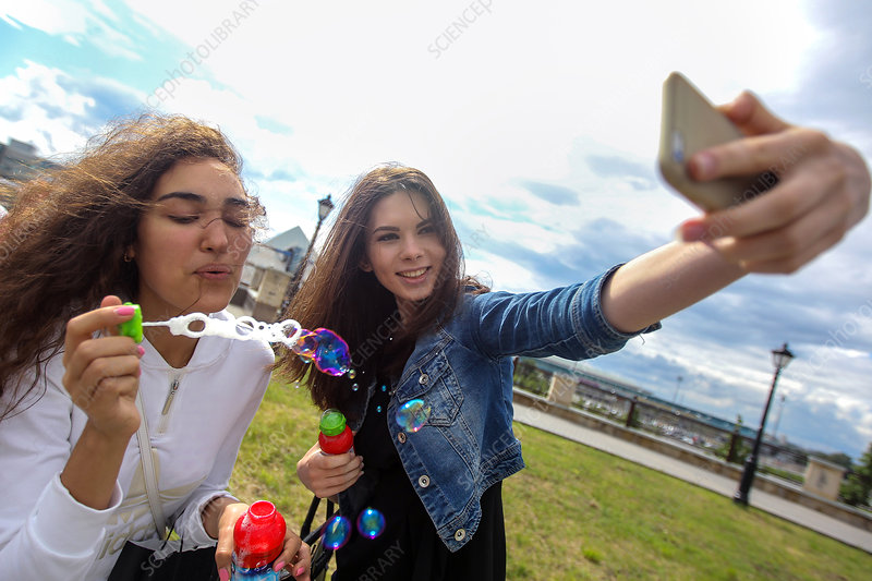 Young women and bubbles selfie