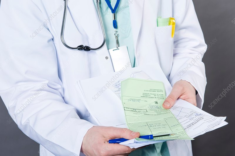 Doctor with health insurance form