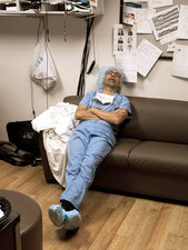 Exhausted surgeon sleeping