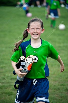 Young female football player
