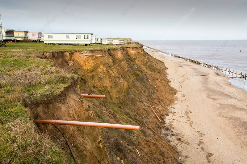Eroded coast revealing drainage pipes