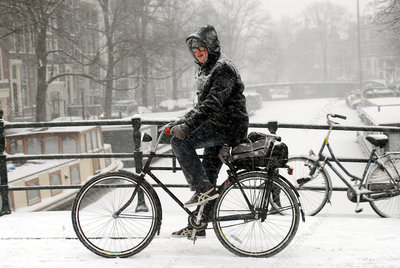 Woman on a bike in snow, Amsterdam