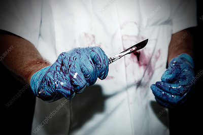 Surgeon with bloody scalpel