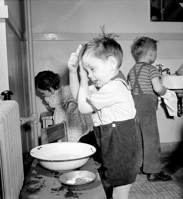 Pre-School Child Combing Own Hair, 1943