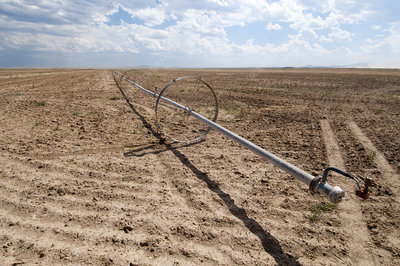 Sprinkler Wheel Line in Fallow Field, USA