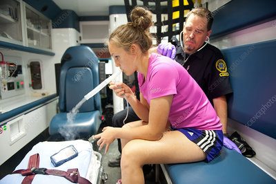 EMT Listening to Asthmatic Patient's Chest