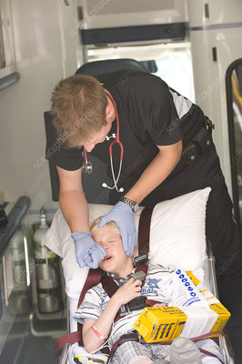 Paramedic Administering Fentanyl to Boy