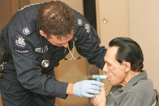 Paramedic Treating COPD Patient