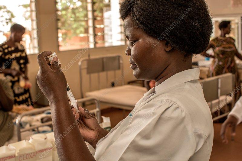 Hospital doctor preparing injection