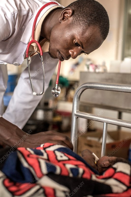 Doctor caring for a baby in hospital