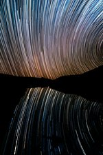 Star trails over river, Chile