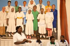 Teacher and students with hospital mural