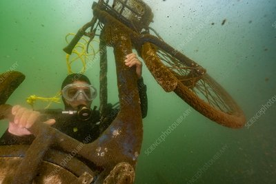 Diver with discarded bicycle