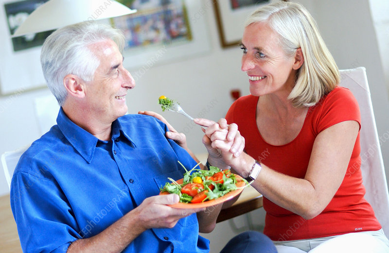 Senior couple eating a salad