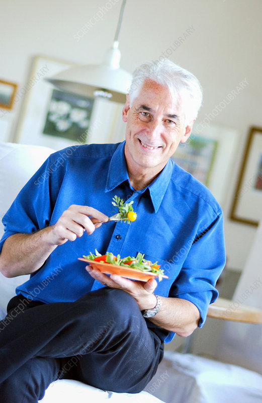 Senior man eating a salad