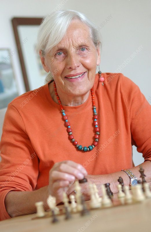 Old woman playing chess