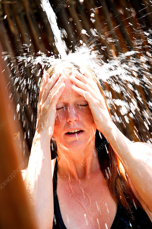 Woman taking outdoor shower