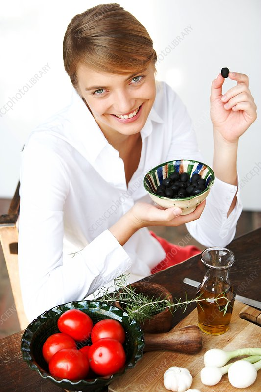 Woman eating olives