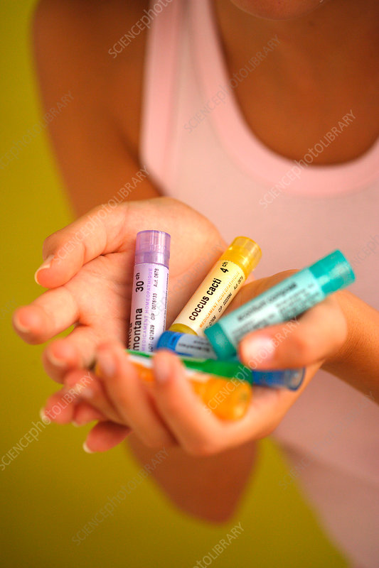 Woman using homeopathic medicine