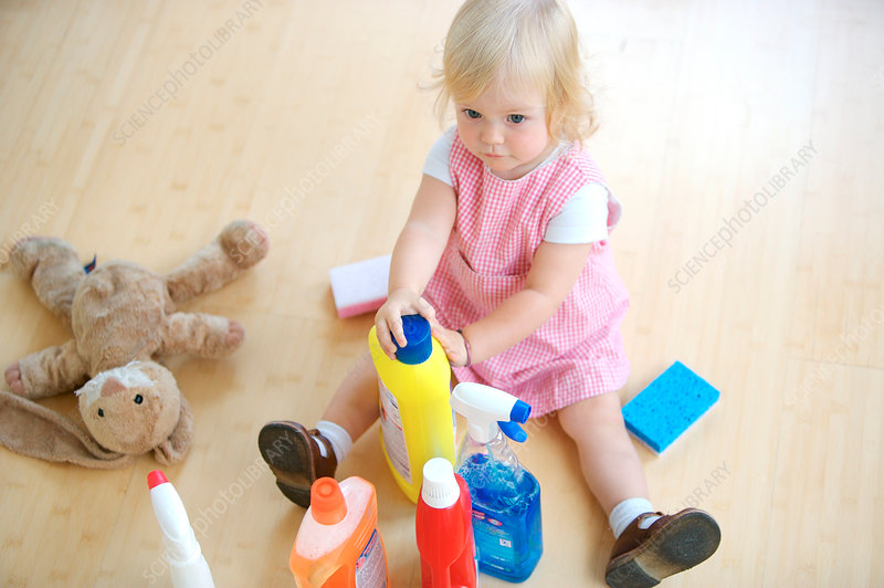 Baby playing with cleaning products