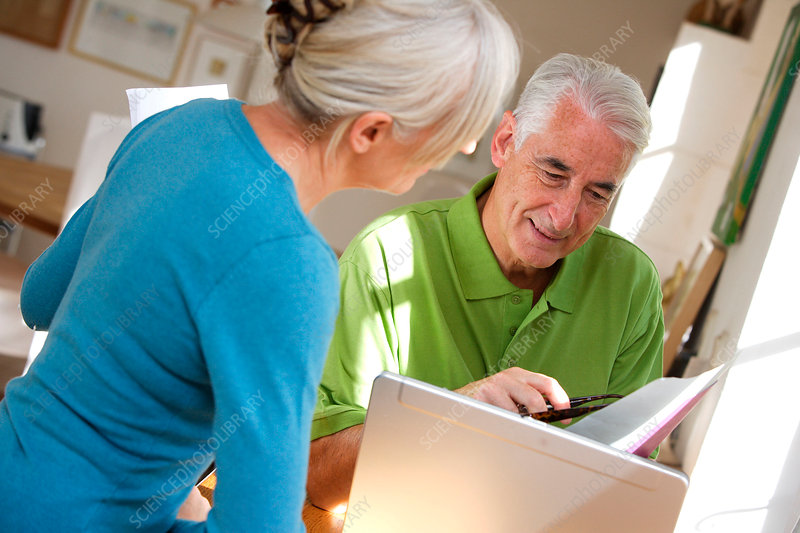 Senior couple checking accounts
