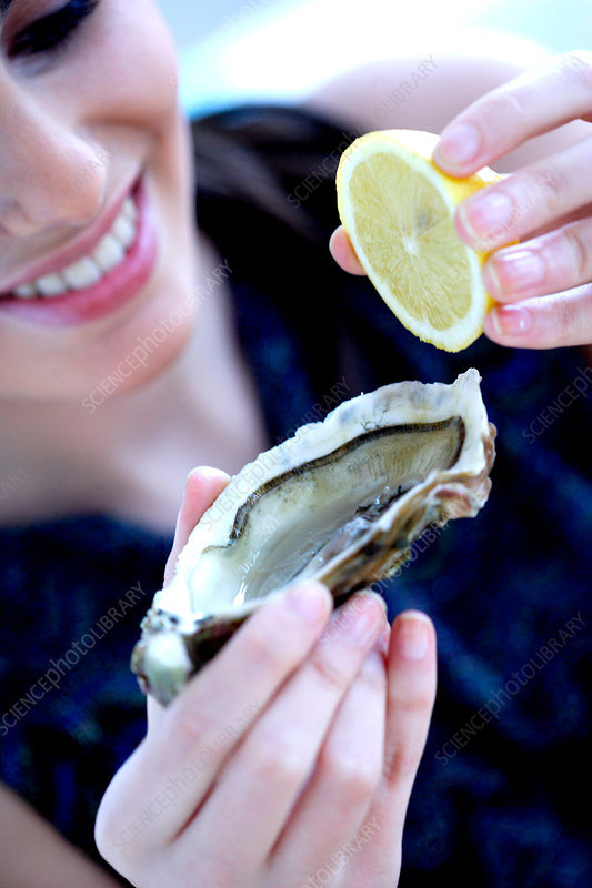 Woman eating an oyster
