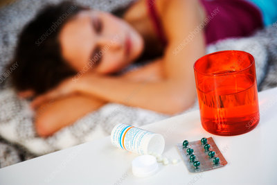 Sleeping woman with pills
