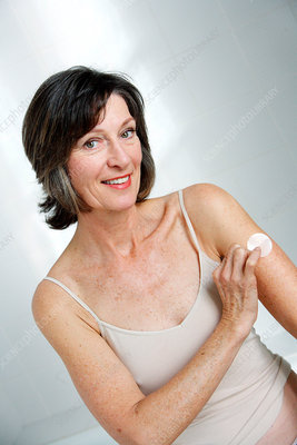 Senior woman using oestrogen patch