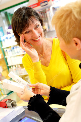 Pharmacist showing products