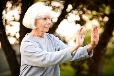 Elderly person doing Tai Chi