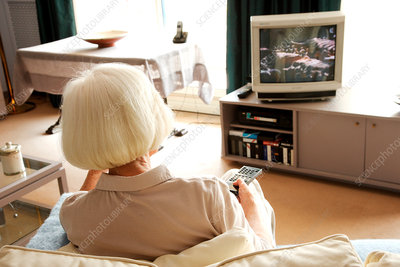 Elderly woman watching TV