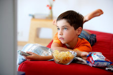 Child snacking and watching TV