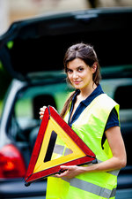 Road safety triangle and vest
