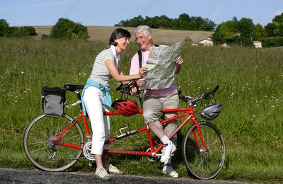 Senior couple riding tandem bicycle