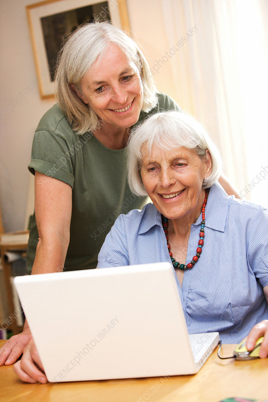 Elderly woman using computer