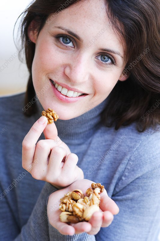 Woman eating walnuts