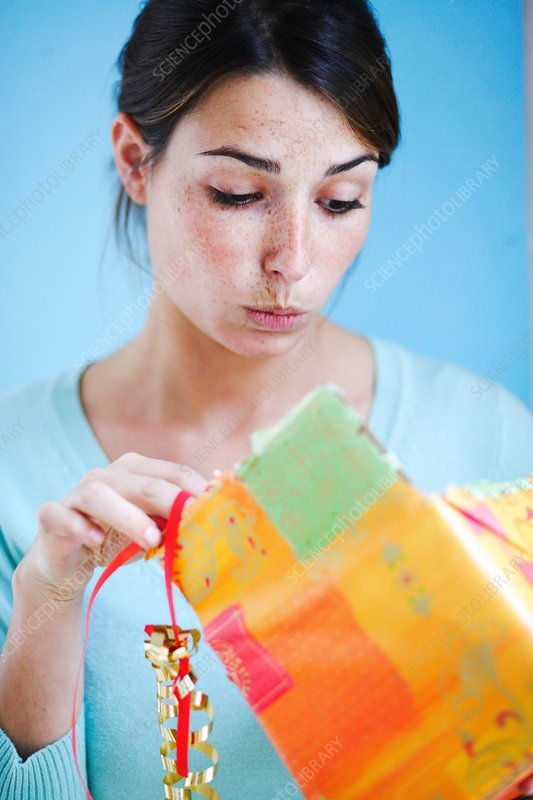 Woman receiving present