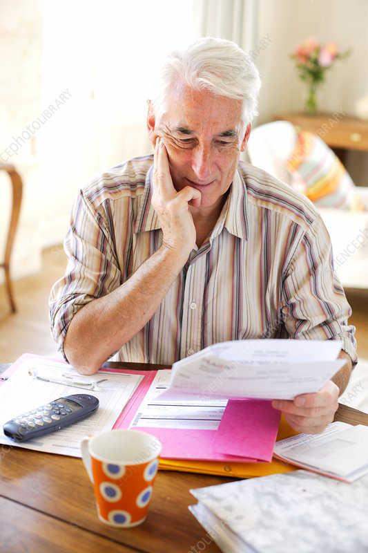 Senior person reading his mail