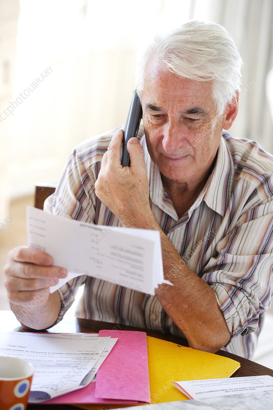 Senior man checking paperwork