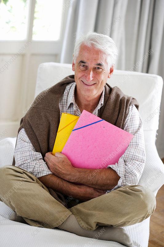 Senior man in chair