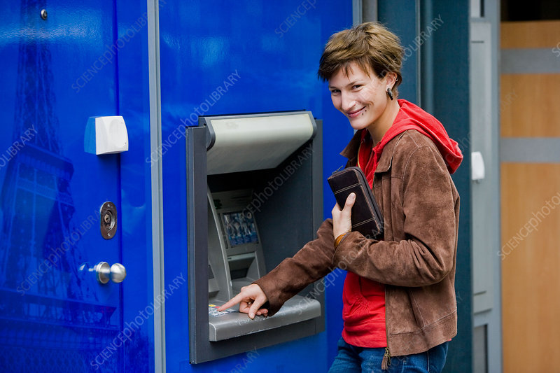 Young woman at cash machine