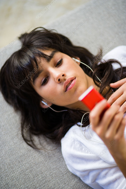 Teenager listening to music