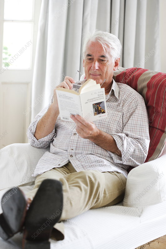 Senior man reading on a couch
