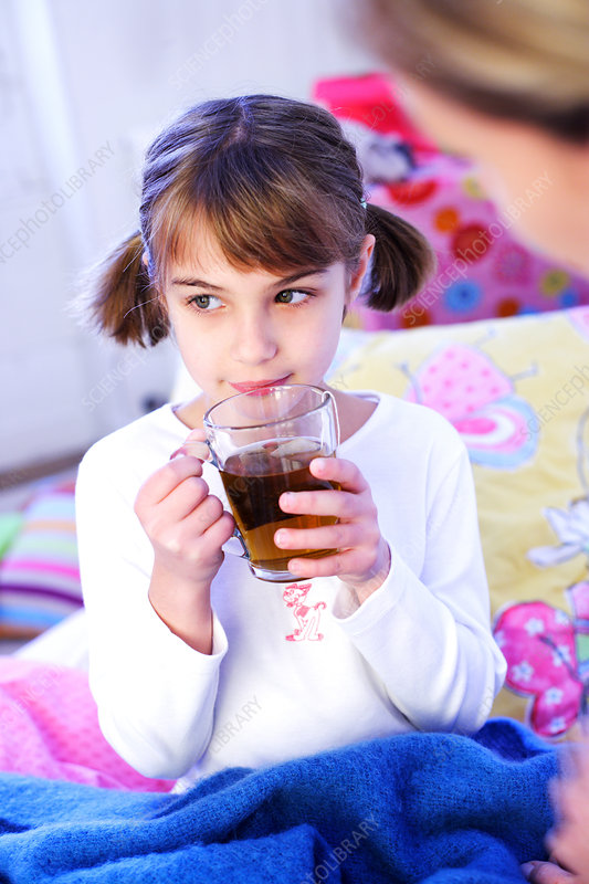 Child drinking in bed