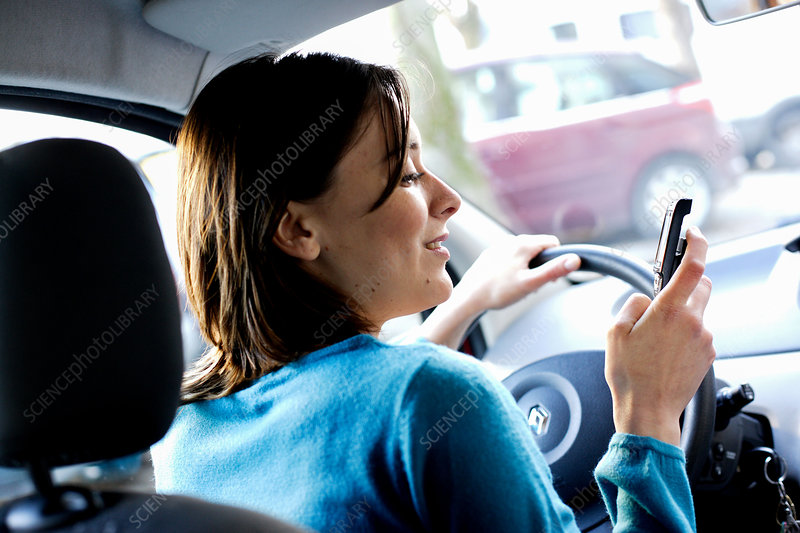 Woman using cell phone when driving