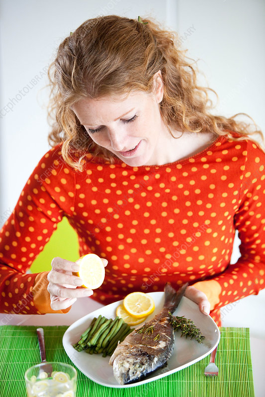 Woman eating fish