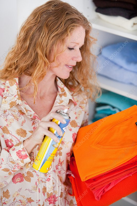 Woman spraying pesticide