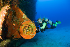 Diver explore the inside of Wreck USS Anderson