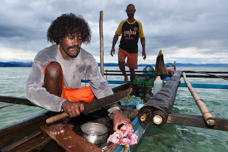 Fisherman on Outrigger Boat